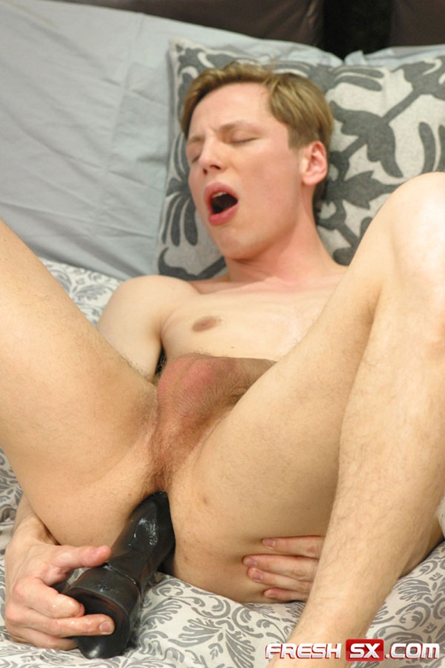 Young man Joshua Webber takes a 11″ black dildo at FreshSX