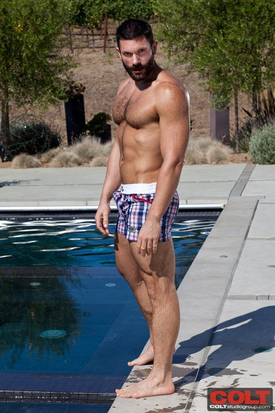Muscle hunk with thick hairy chest Bob Hager jerks off by the pool