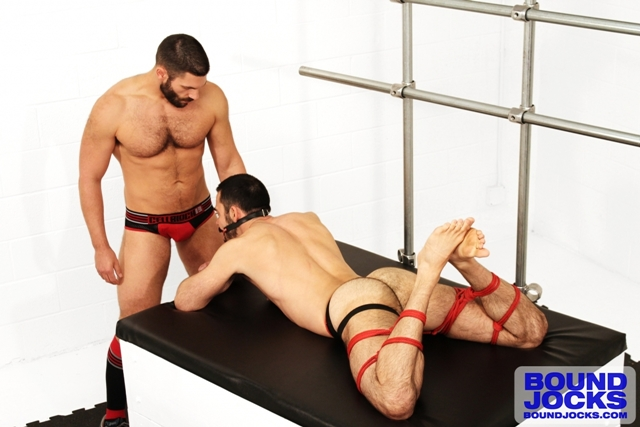 Bound and gagged Dolan Wolf anally abused by Bob Hager at Bound Jocks