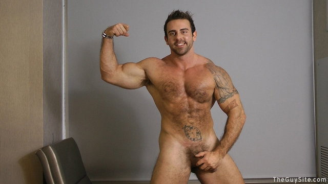Guy-Site--Muscle-hunk-bear-Xavier-big-muscles-dark-fur-tattooed-stud-masturbates-tattoos-001-male-tube-red-tube-gallery-photo