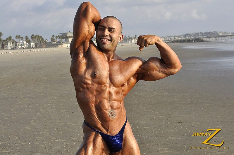 JimmyZProductions-Alavi-Damante-bodybuilder-muscles-oiled-ripped-body-thong-glutes-naked-cigar-smoking-001-male-tube-red-tube-gallery-photo