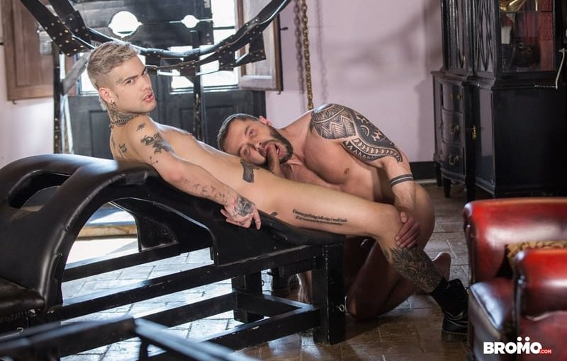 Mickey Taylor fucks Tyler Berg's throat hard then bends him over a bench and spanks his ass
