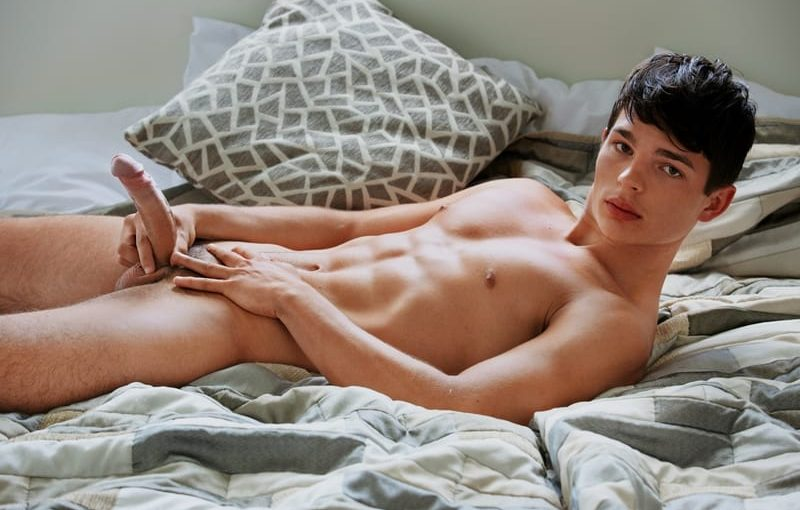 Sexy dark haired young dude Derek Caravaggio strips naked showing off his ripped abs and big erect dick