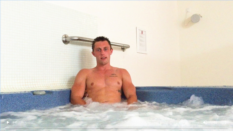 Straight hunk Cameron Donald jerks his big uncut cock in a public Jacuzzi hot tub
