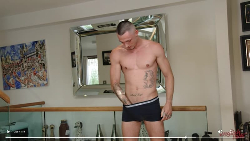 Sexy tattooed English straight boxer Dave Loxley strips our of his kit wanking his big uncut cock