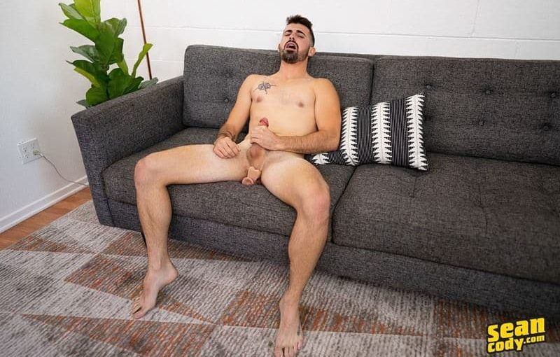 Sexy young hunk Sean Cody Dax had a huge crotch bulge as he strips off his shorts we see his chunky thick cock